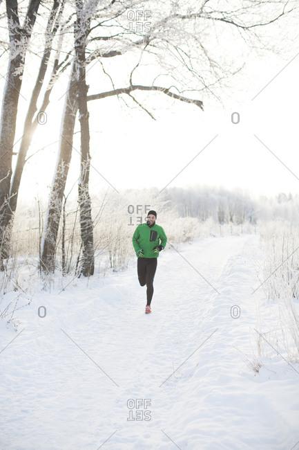 Man running on a snowy road