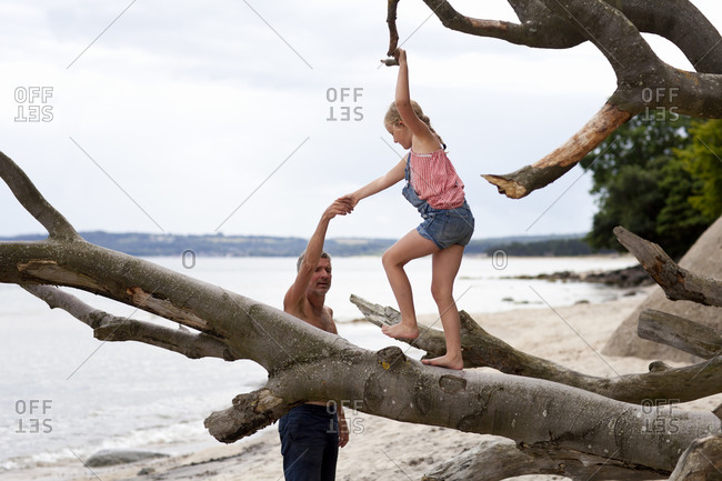 Father with daughter playing on beach