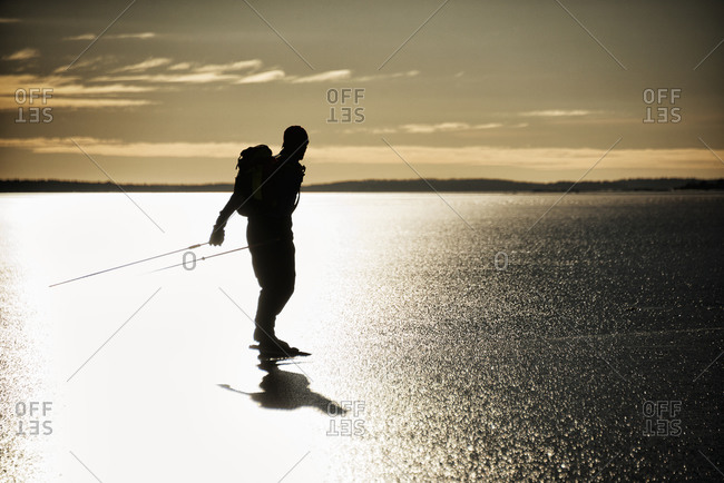 Silhouette of a long-distance skater