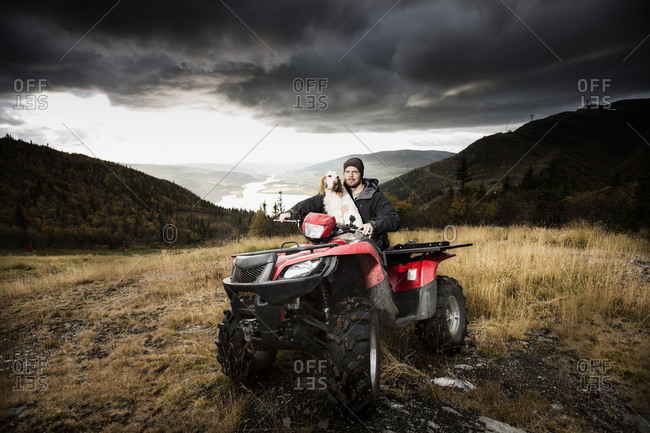 Man with a dog on a quad