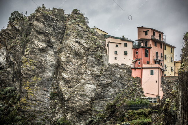 Buildings on a cliff in Italy