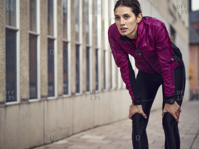 Young woman resting on her morning run