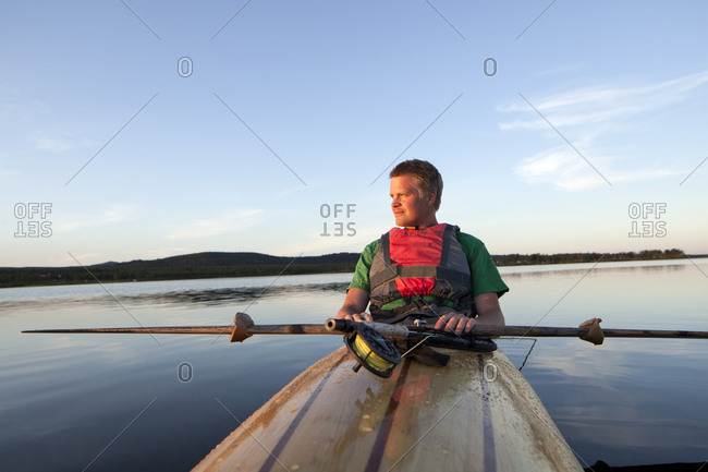 Young man fishing in Kiruna, Sweden