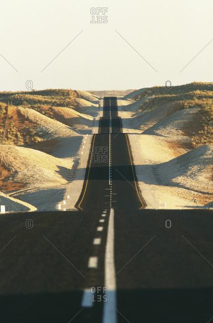 Empty road amidst hills