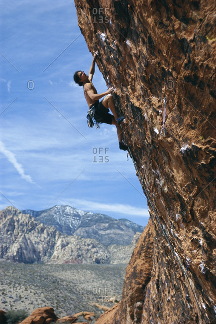 Young man climbing mountain