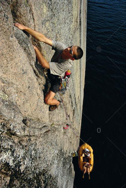 Young man climbing on rock