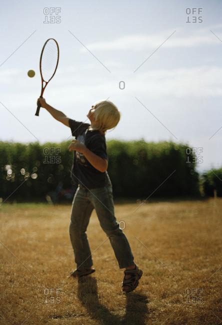 A boy playing tennis