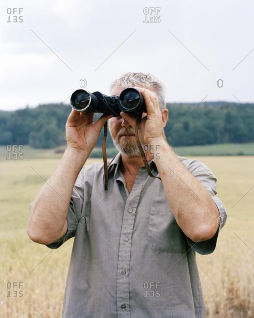 A man with binoculars
