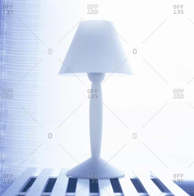 A white lamp in room interior