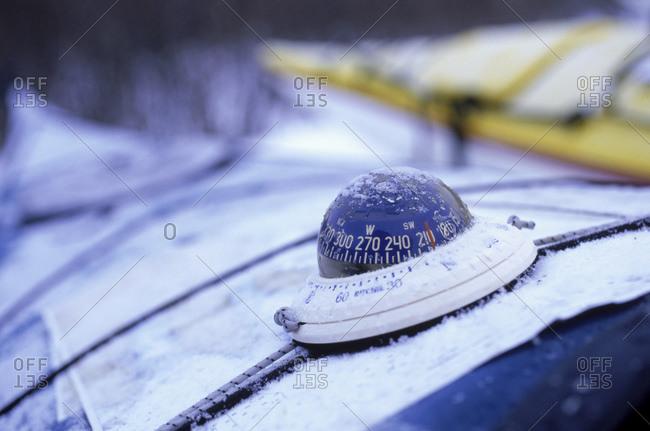 Ice encrusted compass on sea kayak