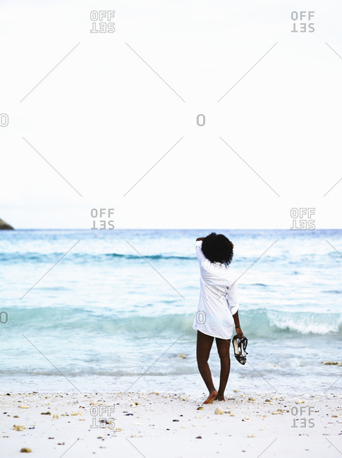 Woman looking out over the sea