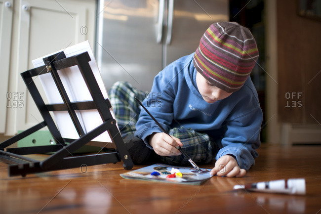 A young boy paints on Christmas morning at his home  in North Yarmouth, Maine.