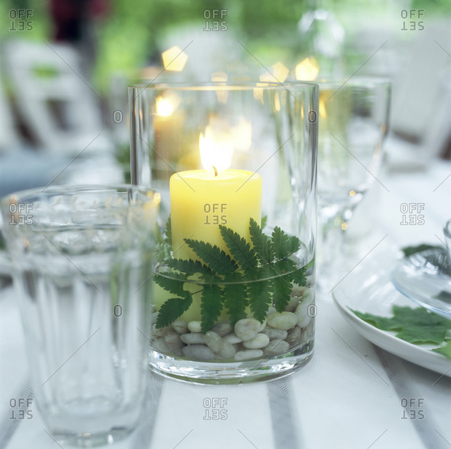 Candle on a laid table