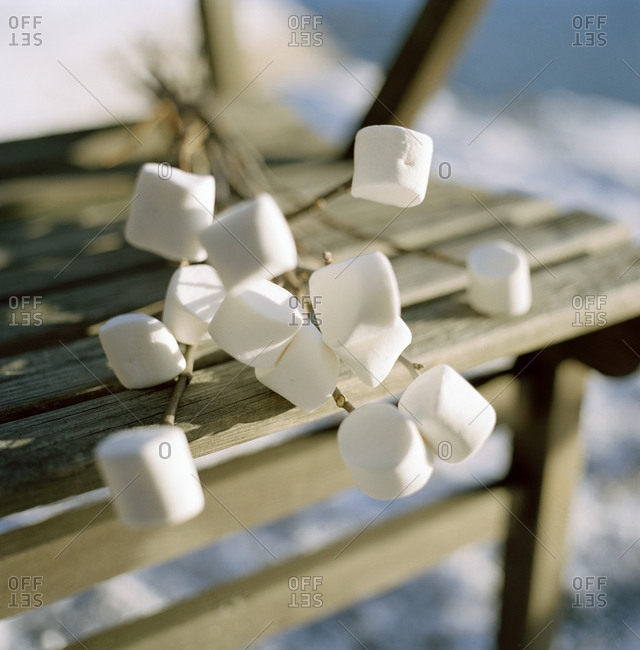 Marshmallows on the end of sticks