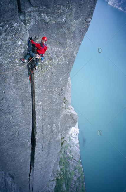 Man rock climbing in Norway