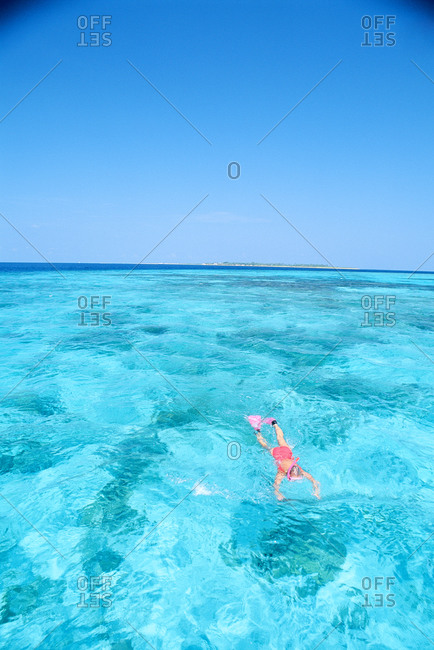 A girl snorkeling in the sea