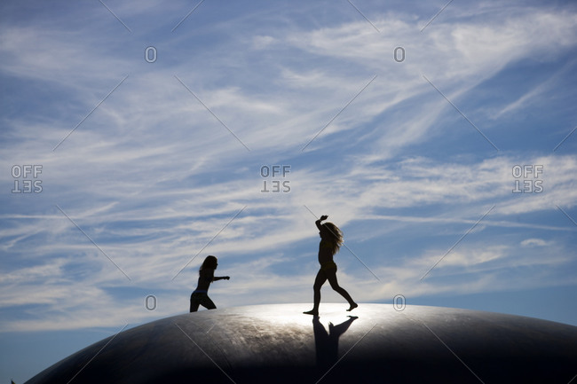 Silhouette of children on a trampoline