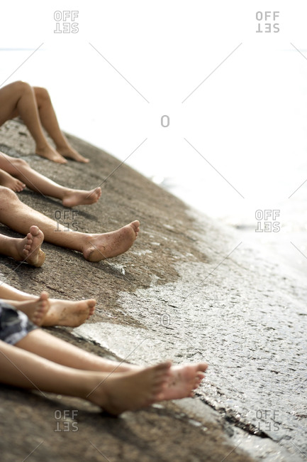 Lower sections of people on the beach