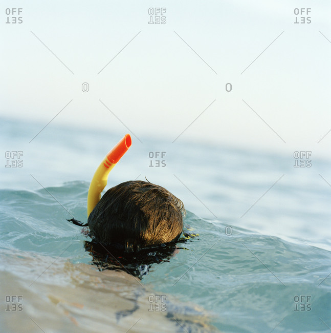 Man with a snorkel in the sea