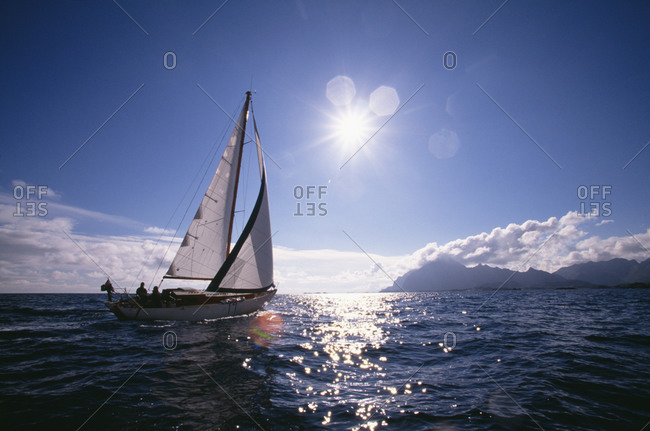 Sailboat on water in sunny weather
