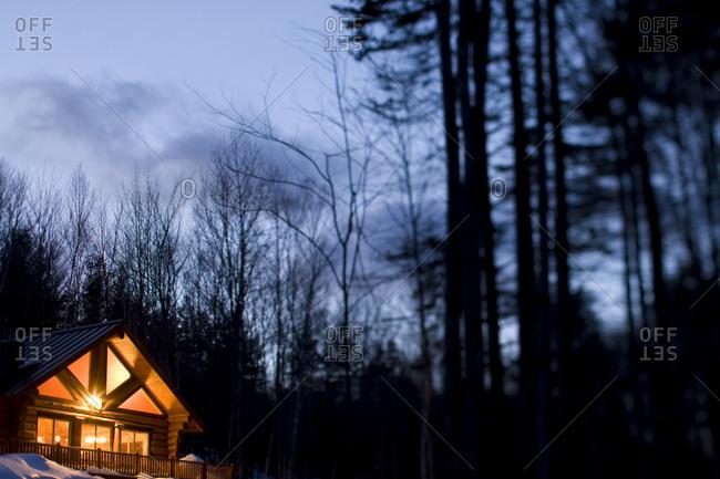 A log cabin at ski resort at night