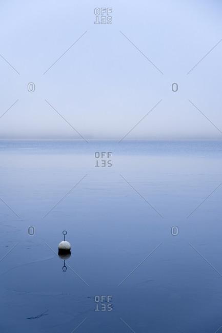 Buoy floating in sea in Nora, Sweden