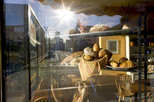 A bakery window in the morning sun