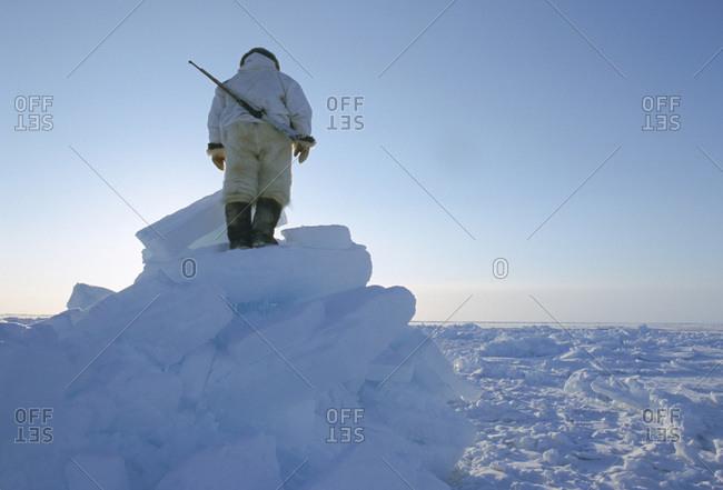 Inuit hunter scanning the  horizon