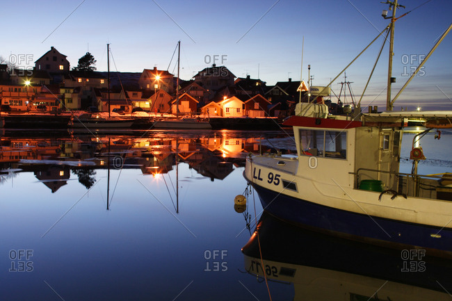 Fishing-boat in harbor by night in Sweden