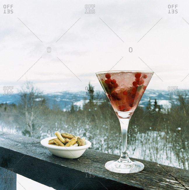 A cocktail and snacks outdoors