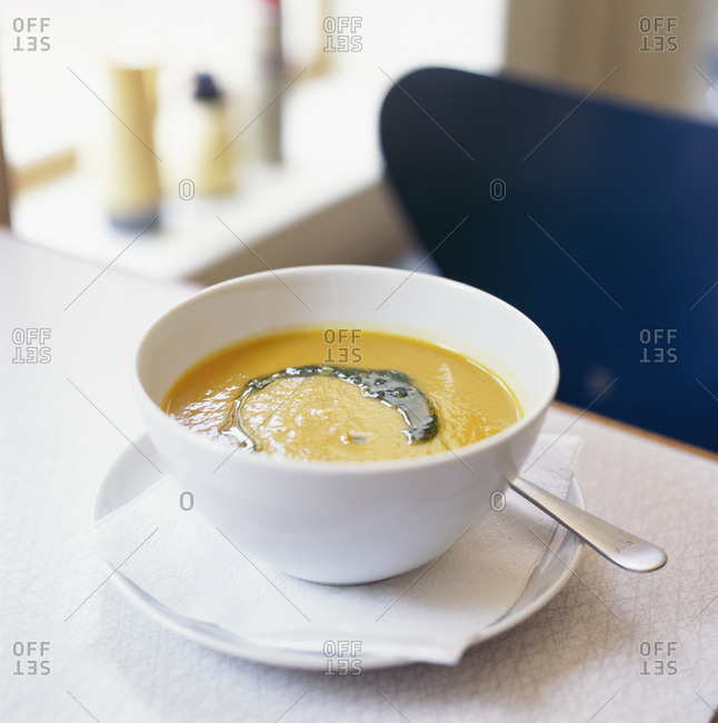 Bowl of creamy soup with dill
