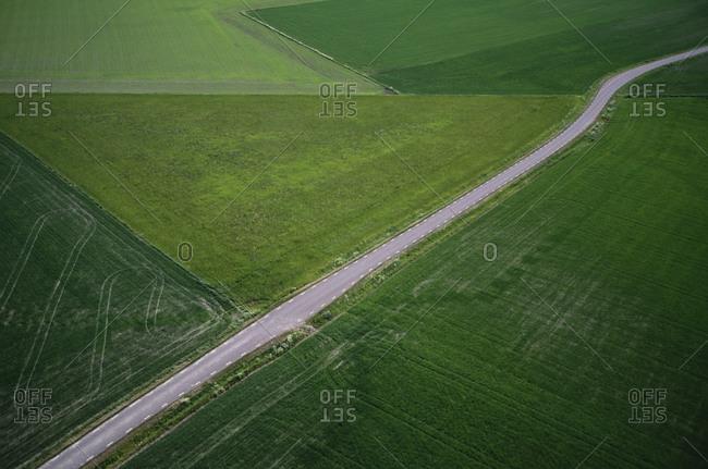 Roadway amidst fields