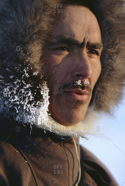 An Inuit hunter in Northern Greenland.  Many of the Inuit who live in this polar region still live a subsistence hunting lifestyle and practice ice age old traditions.   Winter temperatures hover between -20 and -50 Degrees Fahrenheit in this extreme environment.