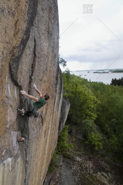 A climber up a mountain in Ostergotland, Sweden