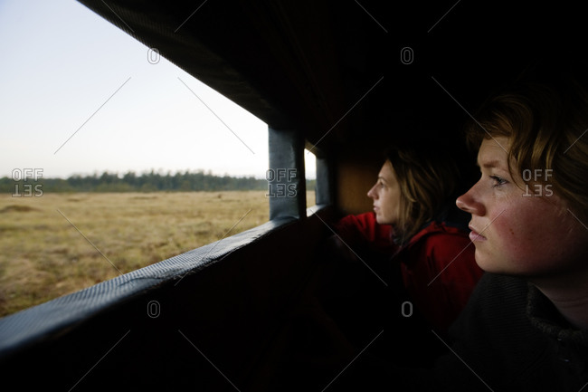 Women bird watching in a bird blind