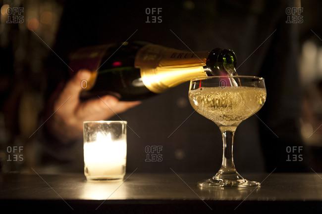 A glass of champagne in a dark bar