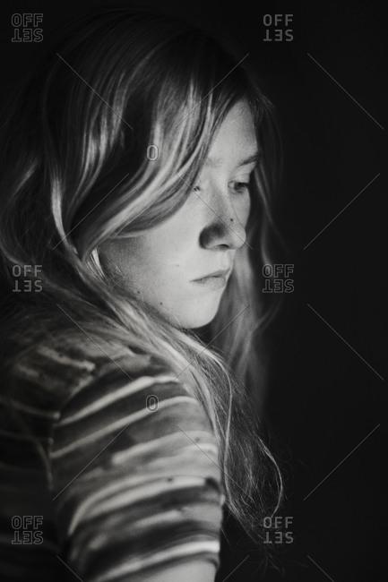 A girl looks over her shoulder