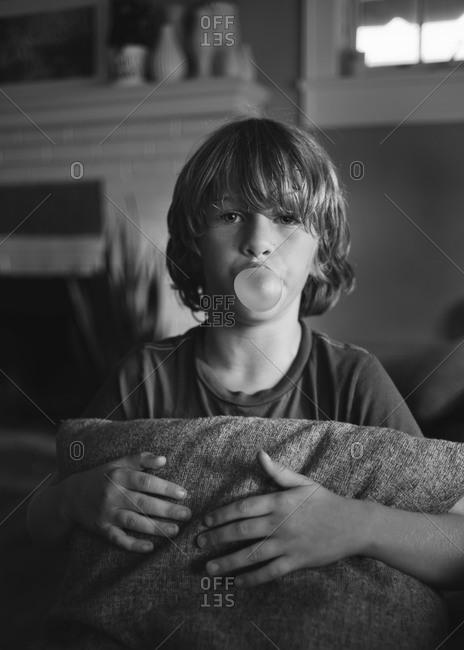 A boy blows a bubble