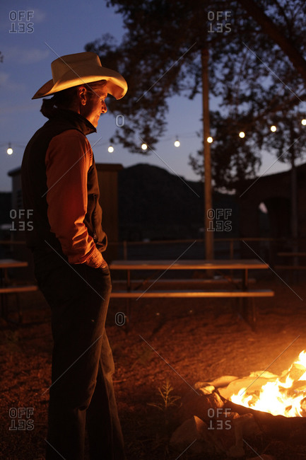 Santa Fe, New Mexico - September 13, 2012: A cowboy stands by a fire pit in Santa Fe, New Mexico