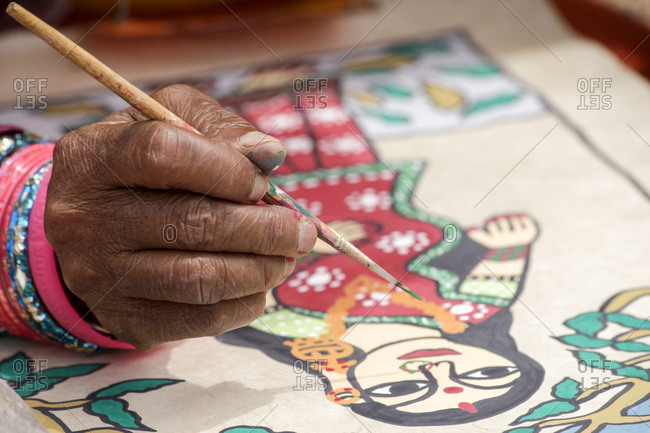 Santa Fe, New Mexico - September 14, 2012: A Rajasthani woman from India works on painting at a folk art market in Santa Fe