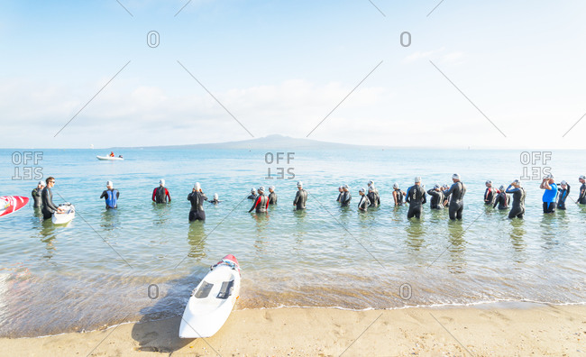 Auckland, New Zealand - January 17, 2013: Triathletes in the sea during a training session at Mission Bay, Auckland New Zealand