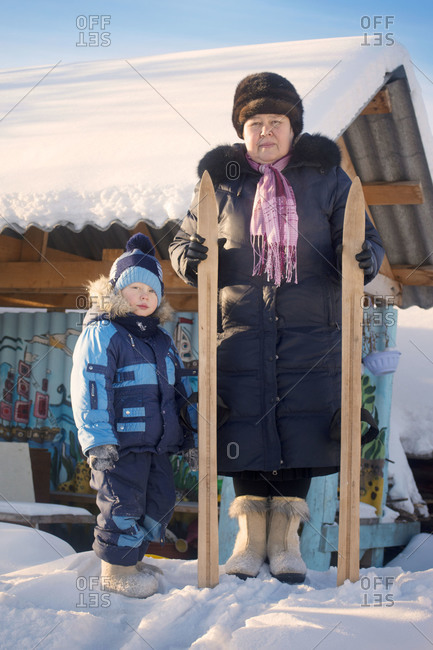 Mother and son posing with wooden skis
