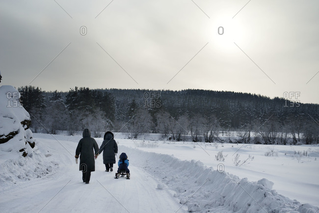Family walking home after day in snow