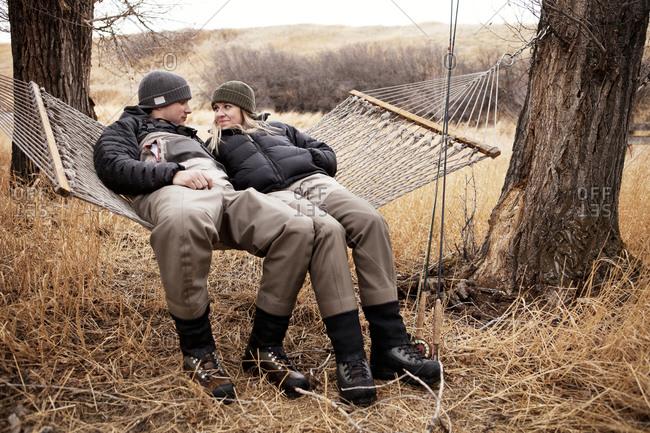 Outdoorsy couple resting on hammock