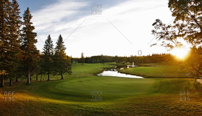 A golf course fairway with a water hazard