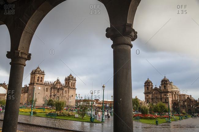 Cuzco, Peru - January 1, 2013: Plaza de Armas with the Cathedral and Iglesia de la Compania de Jesus church in Cuzco, Peru