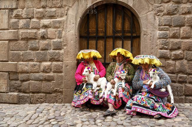 Cuzco, Peru - January 5, 2013: Quechua women in traditional dress at Calle Loreto, Cuzco, Peru.