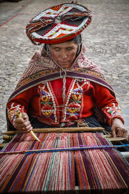 Cuzco, Peru - January 6, 2013: A quechua women weaving a traditional textile in Cuzco, Peru
