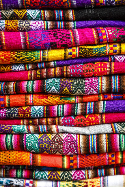 Colorful carpets made of llama and alpaca wool for sale at San Pedro market in Cuzco, Peru