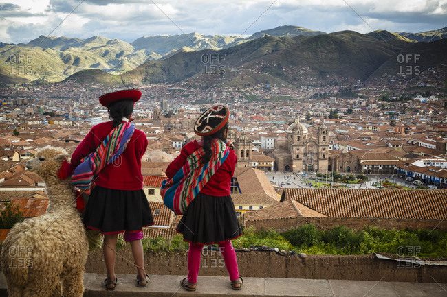 Two girls look out over Cuzco and Plaza de Armas, Cuzco, Peru